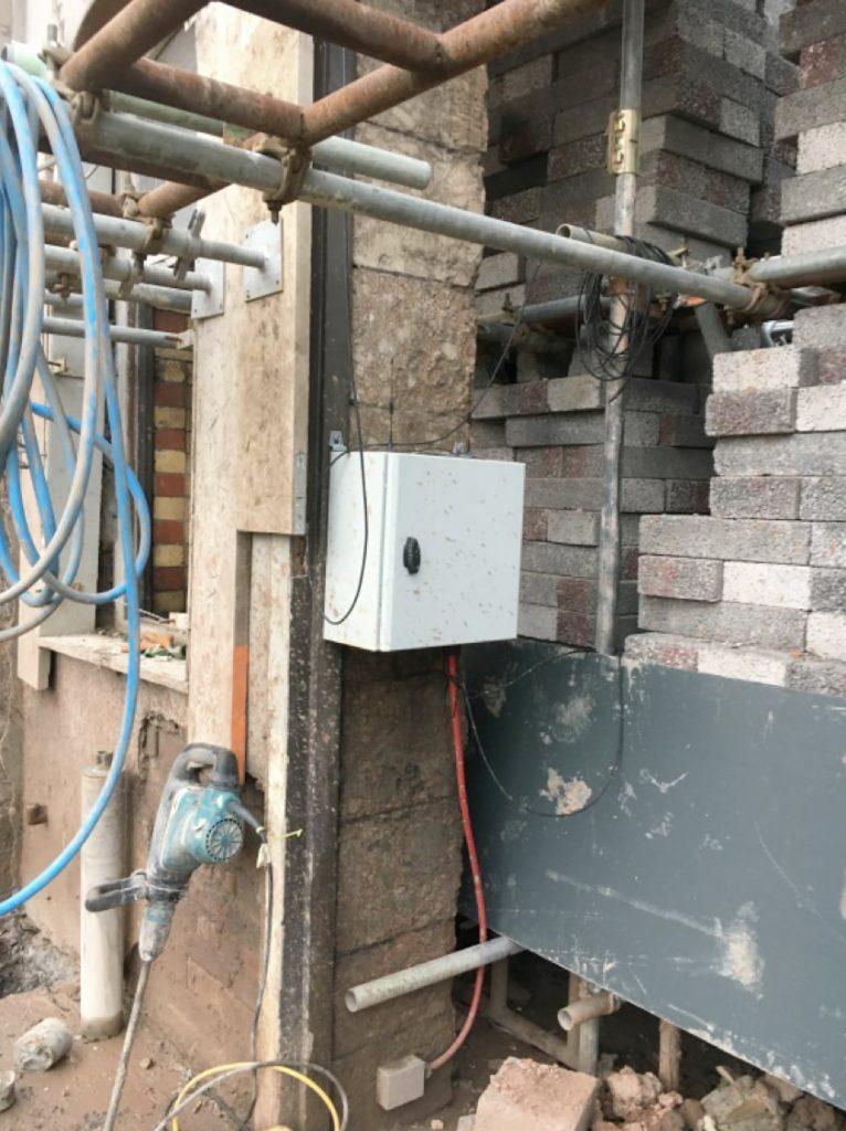 Monitor and accelerometer at facade base